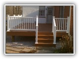 Composite deck with reinforced vinyl railings